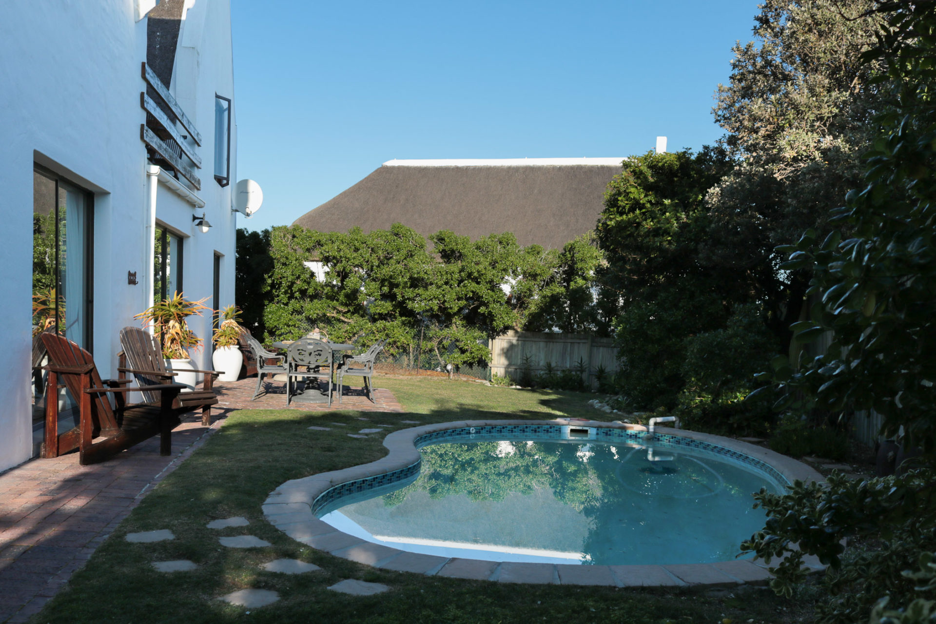 Pool and garden of guesthouse