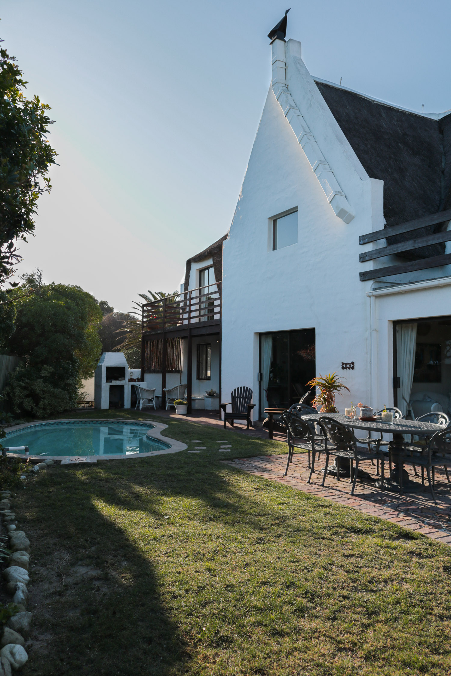 The guesthouse, garden and pool